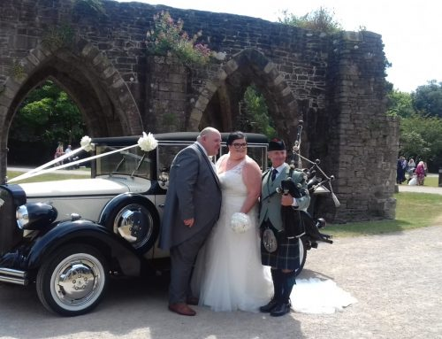 Gareth and Rachel at Margam Orangry with they're piper just married